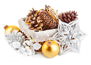 christmas decoration with pinecone in basket isolated on white